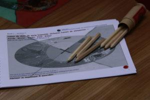 teken de worp in het werkboek van het Pythiaspel!